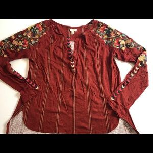 Anthropologie Tiny rust red top w/ floral details